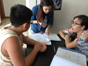 Tutors checking primary science papers from school examinations